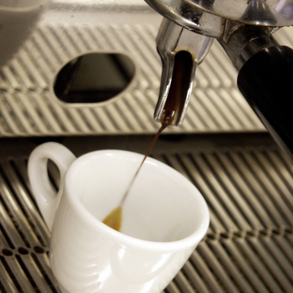 Decaf Coffee Pouring from Commercial Traditional Espresso Machine