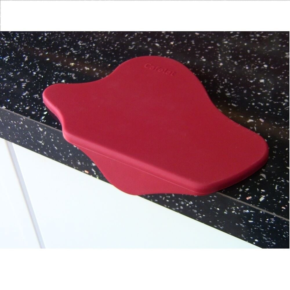 Red Cafelat Splat Tamping Mat Group Head on Cafe Surface