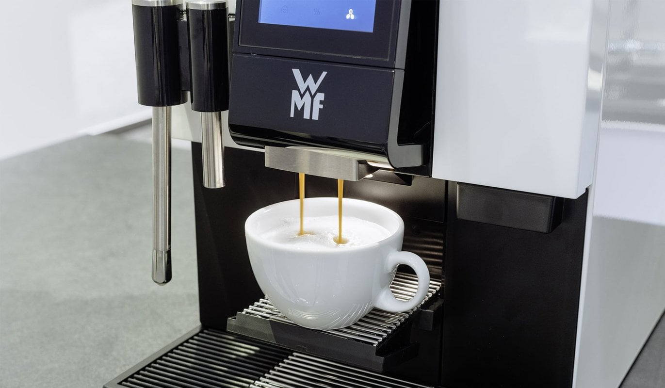 WMF 1100s Bean to Cup Professional Coffee Machine Pouring Cappuccino